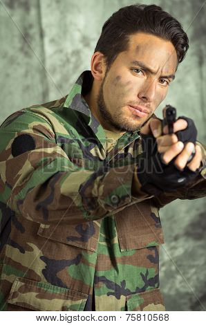 soldier militar latin man pointing a gun