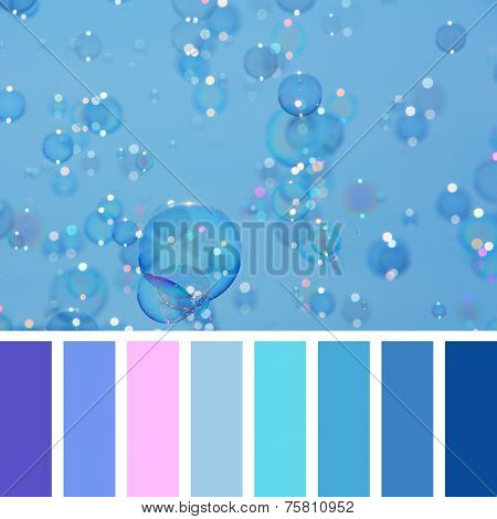 A background of delicate soap bubbles over a blue sky, in a colour palette with complimentary colour swatches