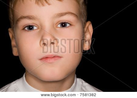 Boy In White T-shirt Isolated On Black Background
