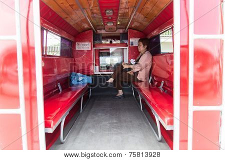The Asian Tourist On The Red Minibus Which Is The Main Transportation Service For Travelling In Chia