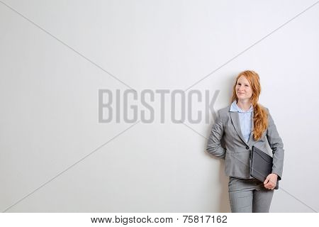 Businesswoman Before A White Wall