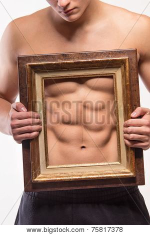 Muscular Man With Six-pack And Frame On His Torso