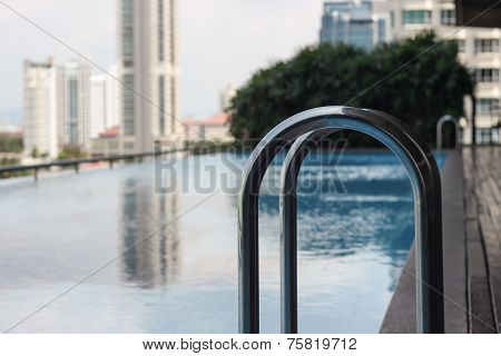 handrail beside the modern swimming pool