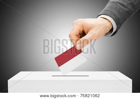 Voting Concept - Male Inserting Flag Into Ballot Box - Monaco