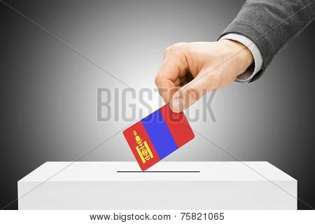 Voting Concept - Male Inserting Flag Into Ballot Box - Mongolia