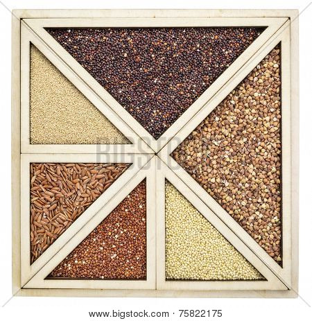 variety of gluten free grains (red and black quinoa, buckwheat, brown rive, amaranth and millet) in a wooden tray