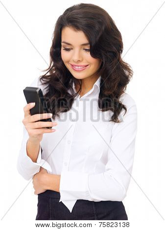 Smiling Young Corporate Woman in Black and White Business Attire Using Her Mobile Phone with One Hand Crossing to her Waist. Isolated on White Background.