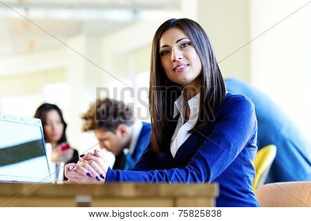 Happy beautiful businesswoman sitting at the table on a meeting