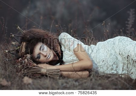 Young Girl In The Image Of A Bride Lying On The Ground