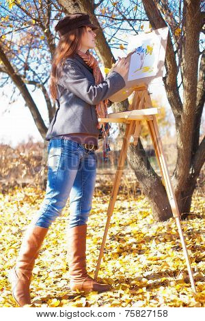 Woman with brush Near Easel