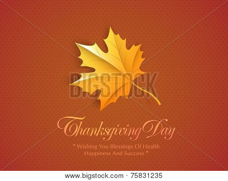 Happy Thanksgiving Day concept with maple leaf and wishing message on orange background.
