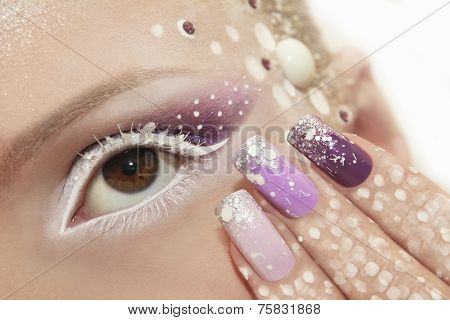 Snow makeup and manicure.
