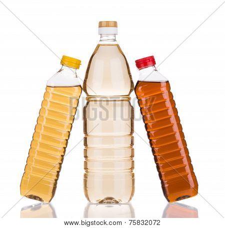 Three bottles of vinegar.