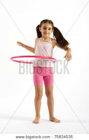 Young Pretty Girl Playing Hula Hoop