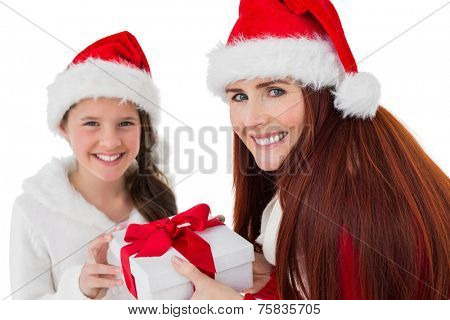 Festive mother giving daughter a gift on white background
