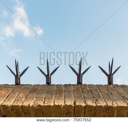 Top Masonry Wall With Sharp Spikes