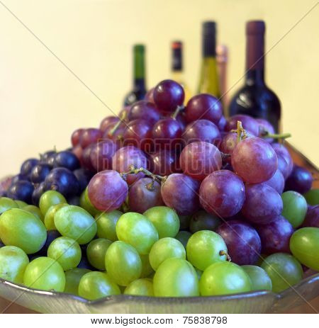 Grapes And Wine Bottles.