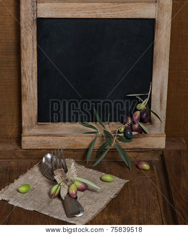Rustic Table Setting With Olive Decor On Old Wooden Table
