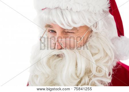 Portrait of santa claus winking on white background