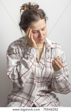 Girl With A Headache And A Drug Pill In Own Hand