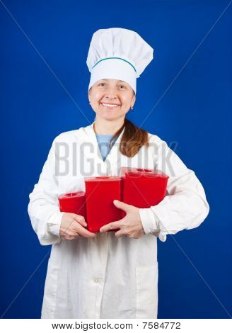Senior Female Cook With  Packages