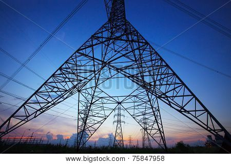 Silhouette Of High Voltage Electric Pole Against Beautiful Dusky Sky Use As Electric Power And Energ
