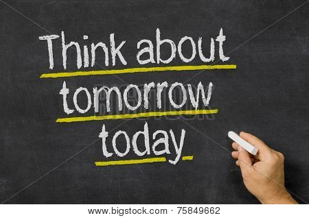 Blackboard with the text Think about tomorrow today
