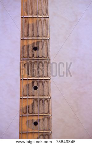 guitar neck and frets