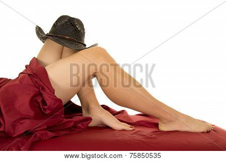 Woman Legs And Red Sheet Cowboy Hat On Knee Barefoot