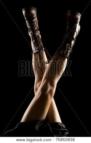 Woman Legs Back Lit Boots Legs Crossed