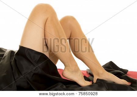 Woman Legs Under Black Sheet Feet Down