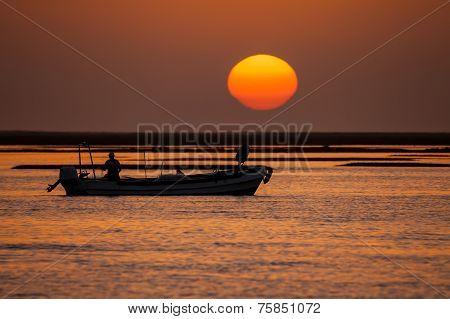 Fisherman Boat At Sunset