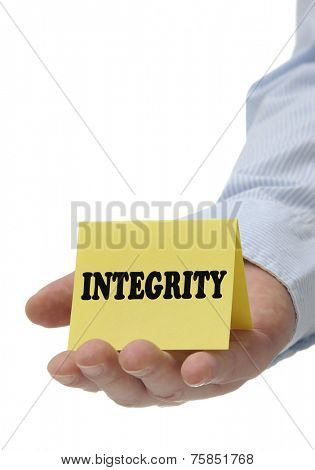 Business man holding yellow integrity sign on hand