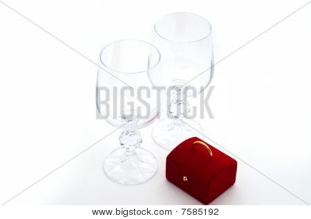 Two wineglasses and surprise box isolated on white