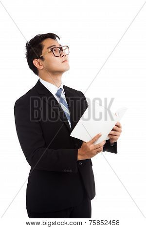 Asian Businessman Read A Book Imagine Of Something