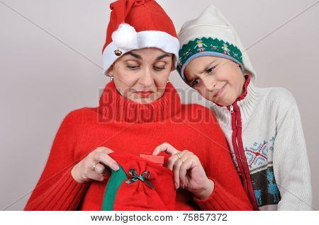 Mother and son looking at Christmas present