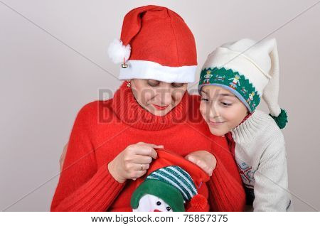 Mother and son looking inside the Christmas stocking
