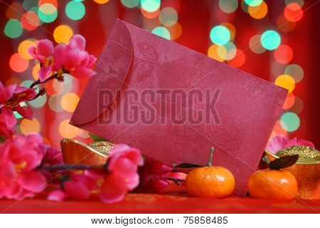 Chinese new year festival decorations, ang pow or red packet with copy space ready for text, on glitter red background.