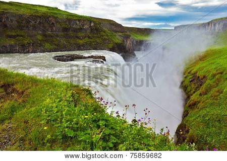 Water abyss. Scenic Gullfoss in Iceland. Over boiling water should cloud splash