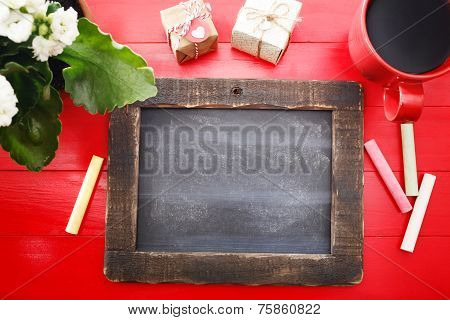 Blank Chalkboard On Red Table