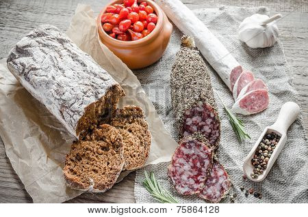 Slices Of Saucisson And Spanish Salami On The Sackcloth