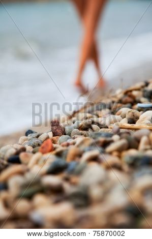 girl walking along the beach barefoot