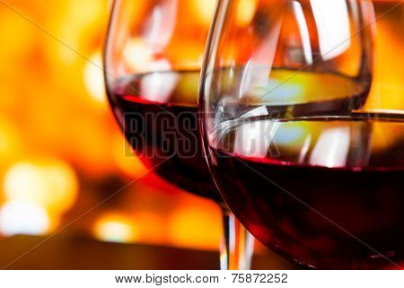 Detail Of Two Red Wine Glasses Against Colorful Unfocused Lights Background