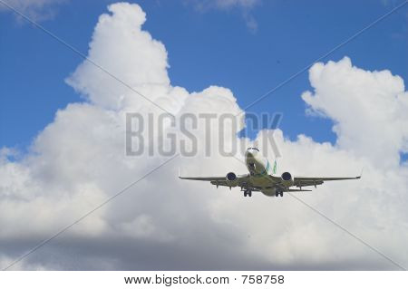 Airplane In A Blue And White Sky