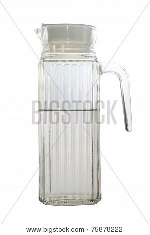 Used glass jug with half clean water isolated on white