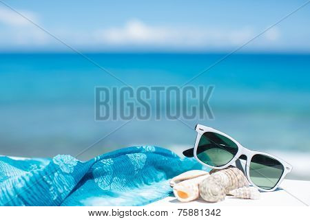 Glasses on the table in a Blue Ocean Beach