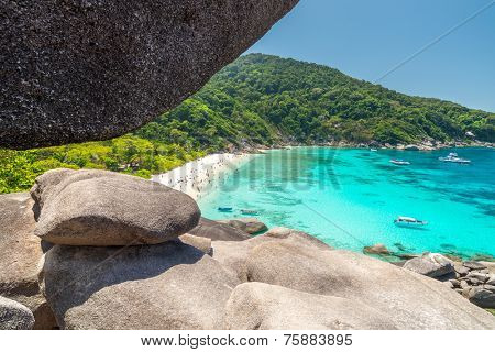 Tourists and boats in a bay Sailing Boat Rock on Koh Similan (Island No.8)