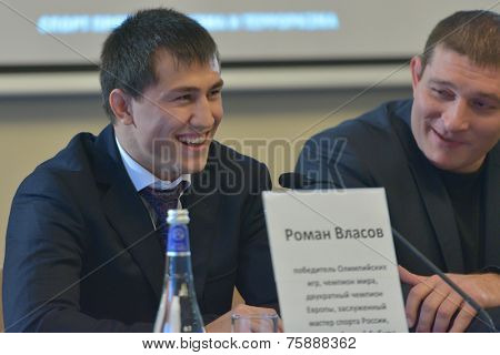 NOVOSIBIRSK, RUSSIA - NOVEMBER 7, 2014: Olympic and World champion in greco-roman wrestling Roman Vlasov on the press-conference before the Friendship Cup. The competitions start on November 8