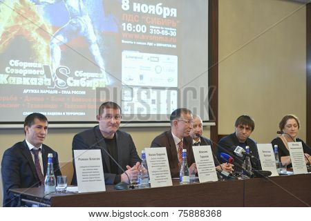 NOVOSIBIRSK, RUSSIA - NOVEMBER 7, 2014: Organizers on the press-conference before the Friendship Cup. Left to right: World champions Roman Vlasov, Hasan Beroyev, Maxim Tarasov, and other