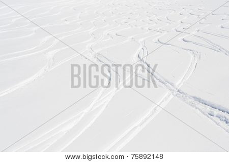 Skiing, snow, freeski - freeride tracks on powder snow